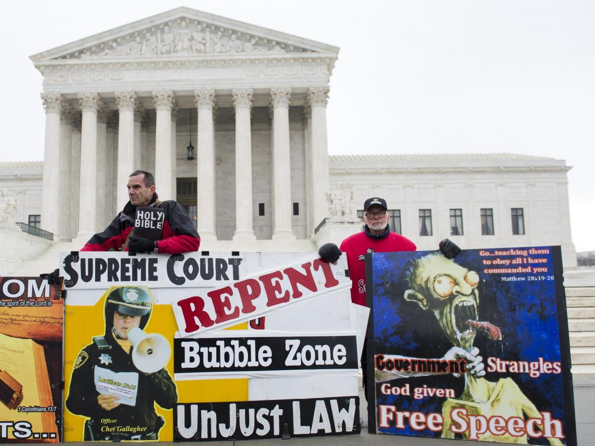 Anti-abortion-rights demonstrators stand outside the U.S. Supreme Court in 2014 after oral arguments over buffer zones around abortion clinics.
