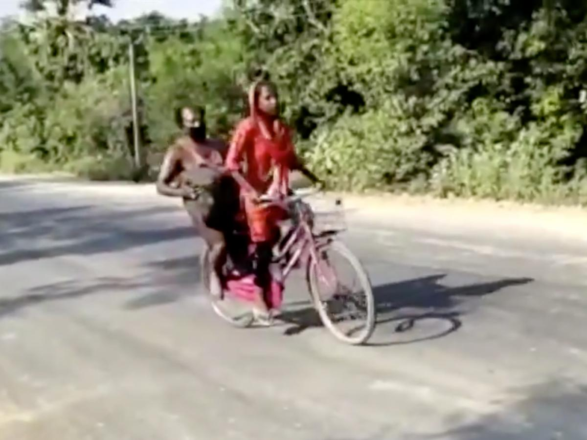 In this screen grab from video posted by BBC News Hindi, Jyoti Kumari, then 15, rides with her father during their 700-mile journey to their family's village of Sirhulli in eastern India.
