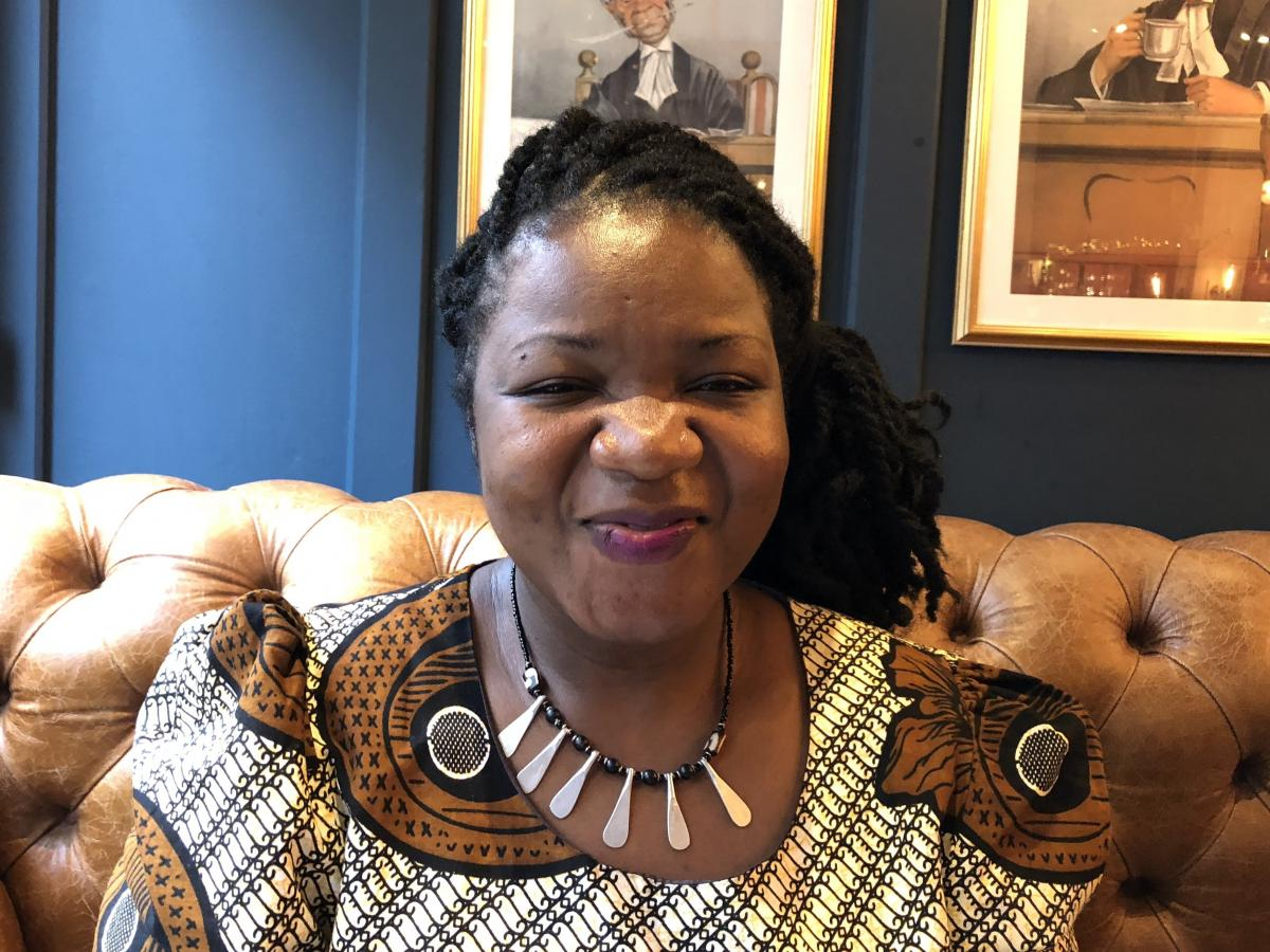Angeline Murimirwa, executive director of the girls' education group Camfed in Africa, at a pub in Oxford, England, in 2018. In August, Camfed was awarded the $2.5 million 2021 Hilton Humanitarian Prize.