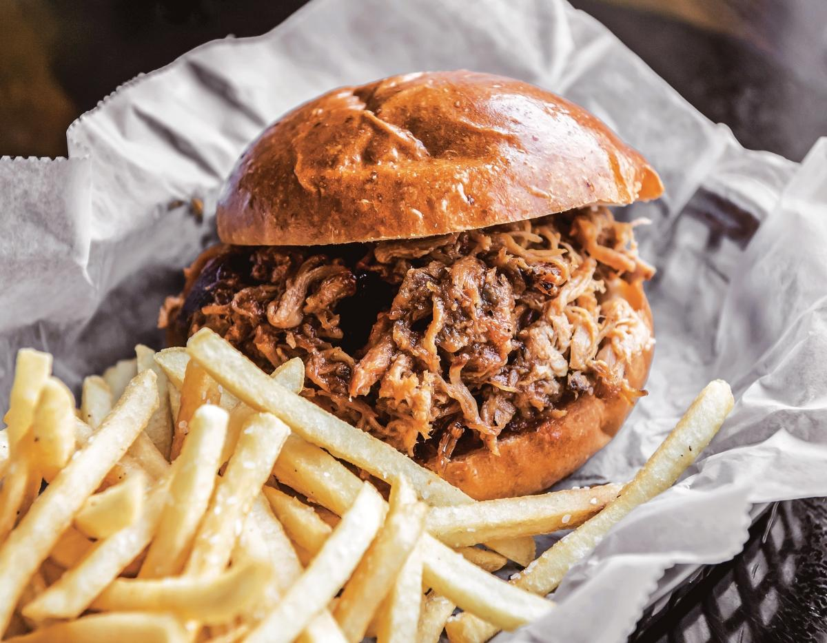 A smoked pulled chicken sandwich from Operation BBQ Relief.