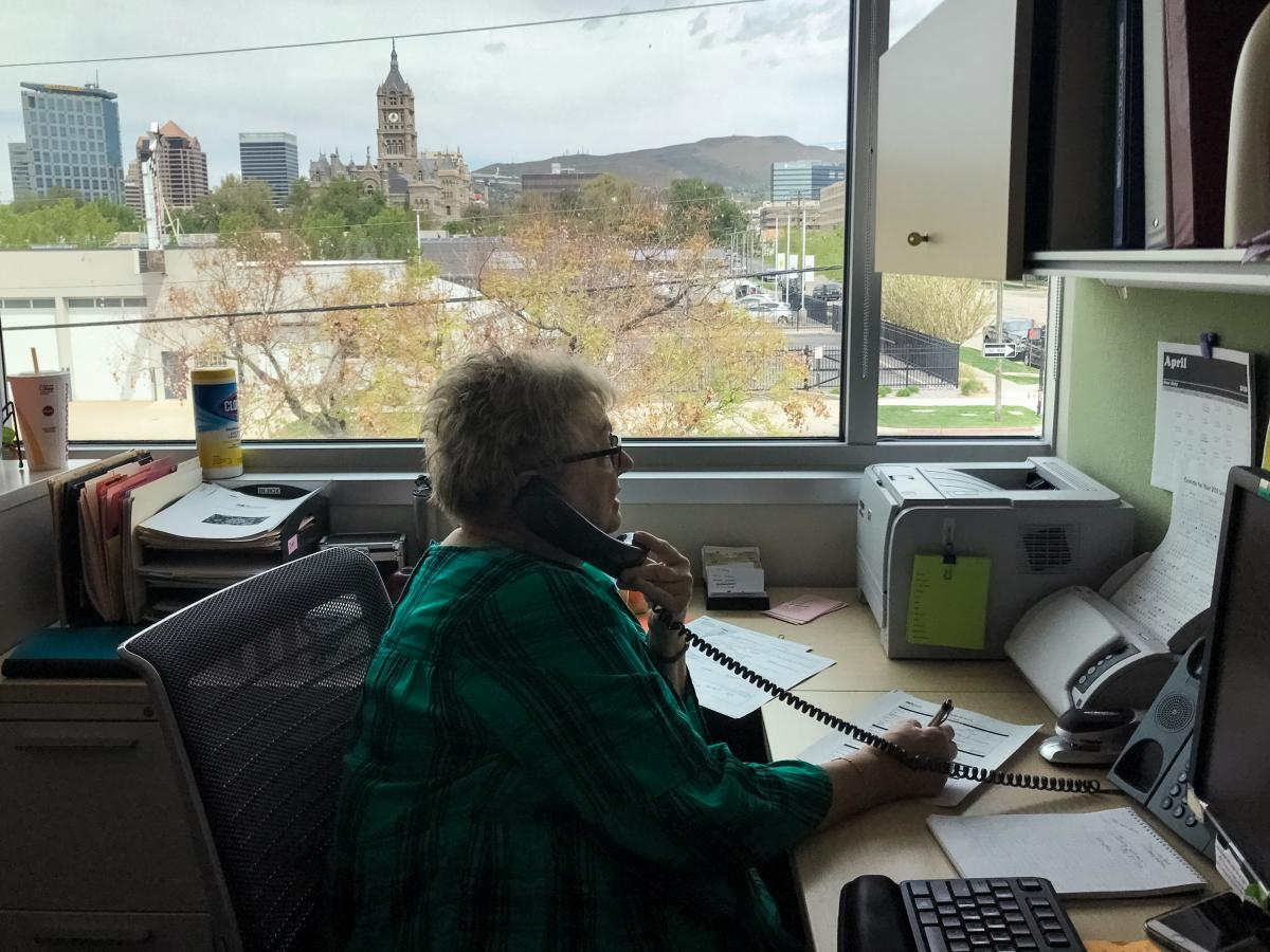 Debbie Sorensen, an infectious disease nurse with Salt Lake County Public Health Department in Salt Lake City, talks by phone with a woman who recently tested positive for the coronavirus. Sorensen is one of the county's 130 contact tracers aiming to slow