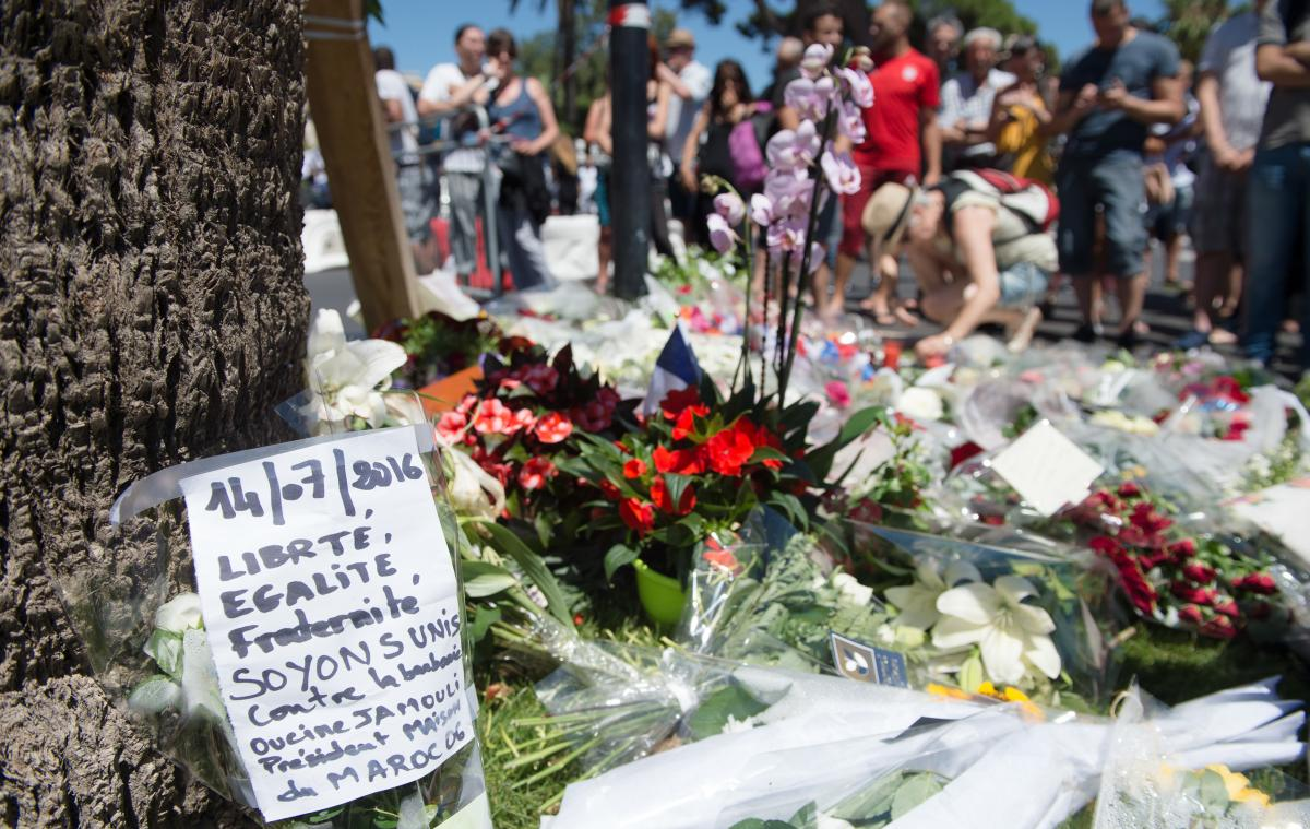 People lay flowers Friday near the seafront in Nice in tribute to victims of Thursday's truck attack that killed more than 80 people. France has suffered three major terrorist attacks since 2015 and appears as vulnerable as any Western nation.
