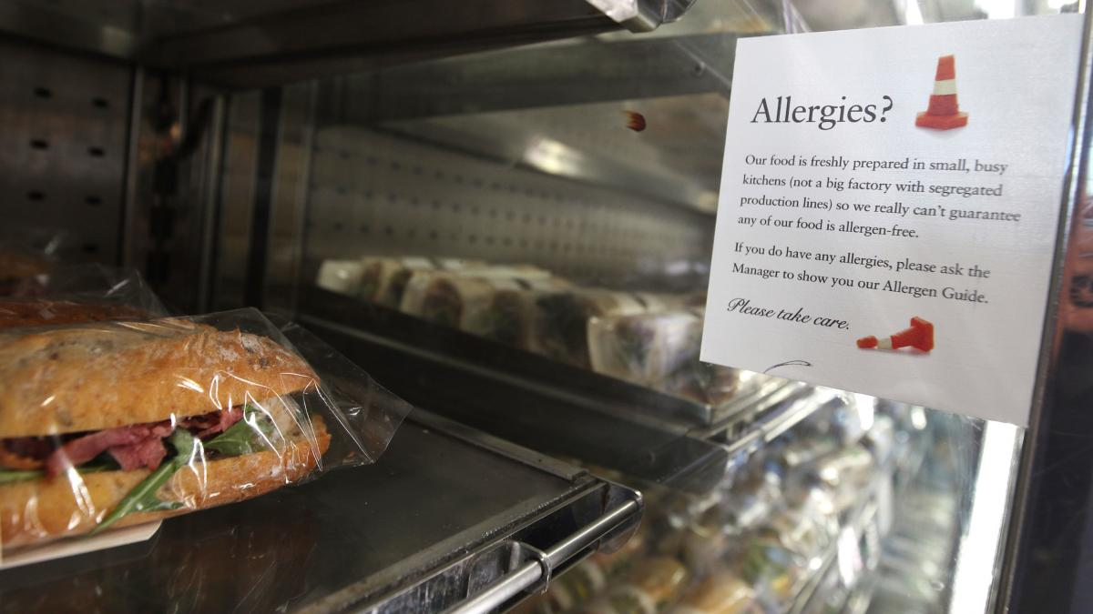 An allergy warning notice is displayed next to food in a branch of Pret A Manger in central London. Pret A Manger is working to have full ingredient labeling in all its British shops by the end of 2019.
