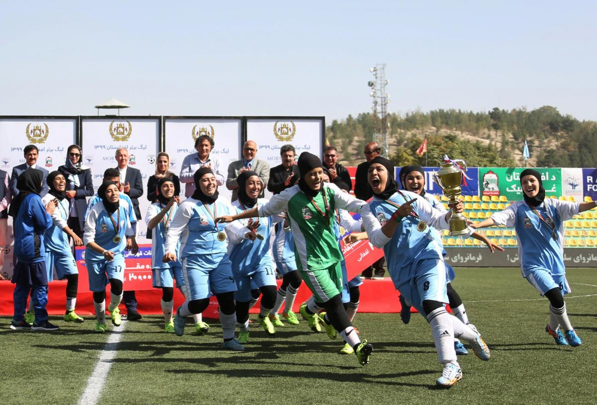 Players from the Herat Storm celebrate after winning the championship of the Afghan women's soccer league on October 16 in Kabul.