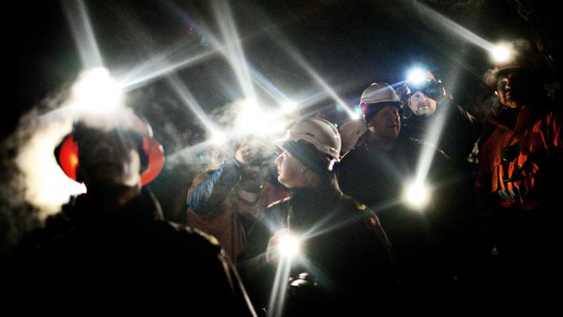 Workers stand inside the gold mine in Greenland's Nulanaq mountain in 2009. The Danish territory's underground wealth was at the forefront of elections in March. Now, Greenland faces another dilemma: whether to end a zero-tolerance policy on uranium extra