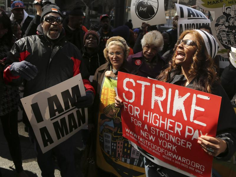 Demonstrators from the Fast Food Forward rally protest Thursday outside a Wendy's restaurant in New York City.