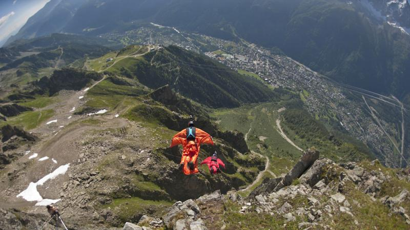 In 2012, these two base jumpers wearing wingsuits were high above Chamonix in the French Alps.