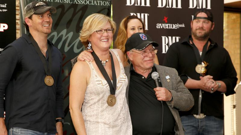 "On Monday, the team behind Lee Brice's ""I Drive Your Truck"" gathered in Nashville to celebrate the song's reaching No. 1 on the Billboard Country Airplay chart. From left: co-songwriters Jimmy Yeary, Connie Harrington and Jessi Alexander, military father"