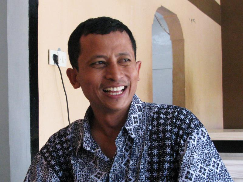 Convicted ex-terrorist Mahmudi Haryono recounts his experiences while sitting at a table at the restaurant where he works in Semarang, Indonesia. The restaurant is one of three founded by social entrepreneur and reformed radical Noor Huda Ismail, to help