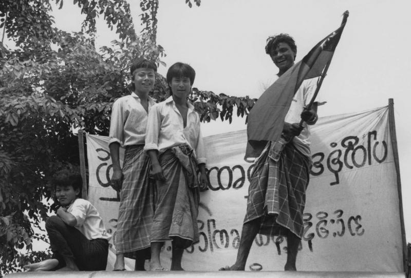 Democracy demonstrators wave the Burmese flag in August 1988, when millions of Burmese took to the streets. Students led the protests, but were soon joined by civil servants, police, soldiers and ordinary citizens.