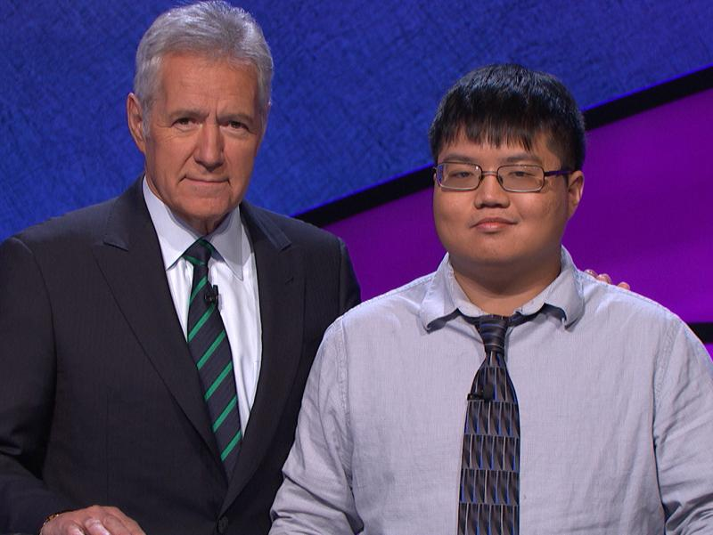 Game show contestant Arthur Chu with host Alex Trebek on the set of Jeopardy!