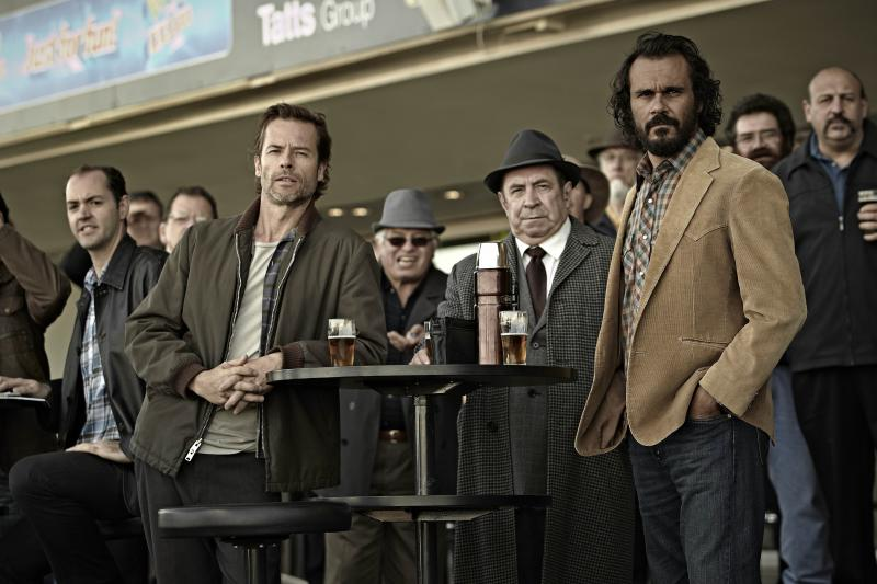 Guy Pearce (front left) plays Jack Irish in TV movie adaptations of two Peter Temple novels. The films, Bad Debts and Black Tide, are broadcast by digital provider Acorn TV.