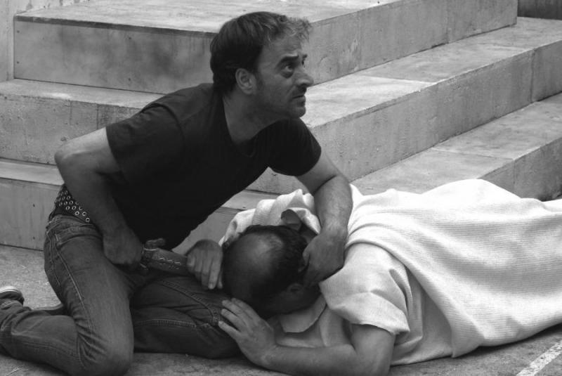 Brutus (Salvatore Striano) fixes a wild stare at the witnesses and conspirators after Julius Caesar's murder, in a scene from Paolo and Vittorio Taviani's Caesar Must Die.
