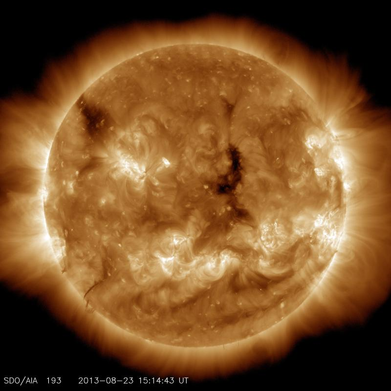 This image highlights the outer atmosphere of the sun, called the corona, as well as hot flare plasma. Hot active regions, solar flares and coronal mass ejections appear bright here. The dark areas, called coronal holes, are places where very little radia