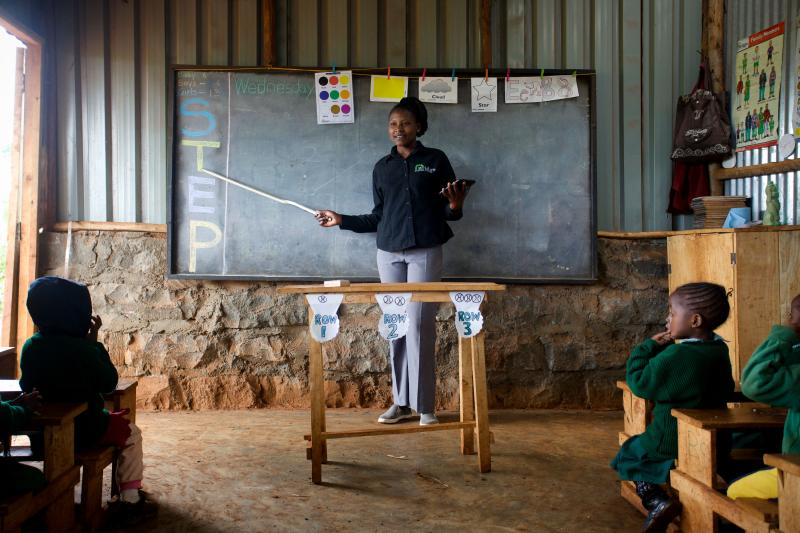 A teacher at the Bridge International Academy school in Kinoo, near Nairobi, Kenya, gives a lesson to young students. Bridge, a private, for-profit company, has set up more than 200 schools in the country.