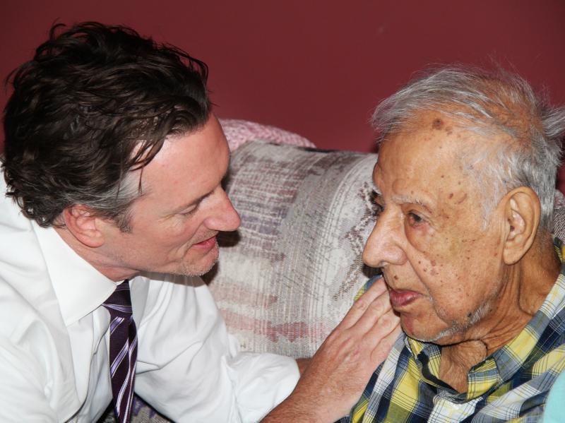 Dr. Tim Ihrig, a palliative care physician, treats Augie Avelleyra, 93, at his home in Fort Dodge, Iowa.