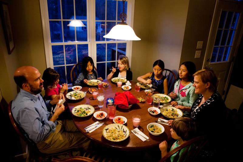 The Brown-Spencer family gathers for dinner at their home in Mechanicsville, Va. This family of eight manages to eat together nearly every weeknight, but they've had to cut back on many after-school activities to make it work. From left: Doug Brown, Laura