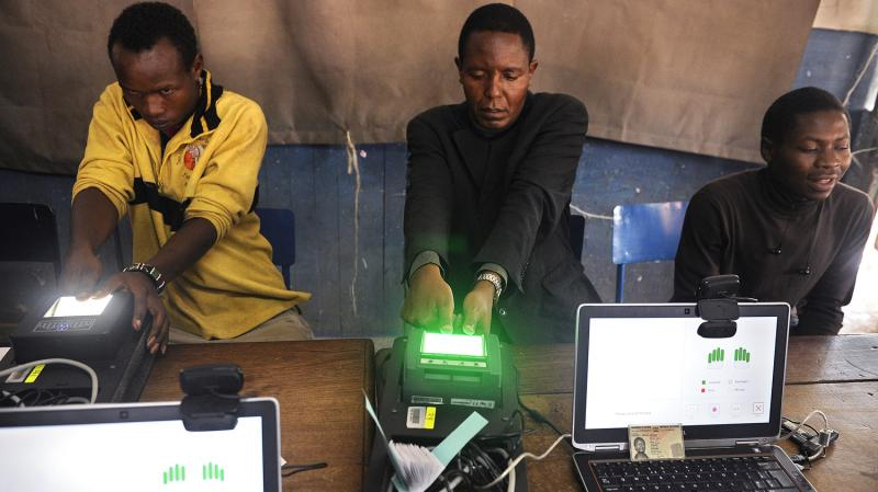 Kenyan authorities are trying to guard against fraud and violence when they hold a presidential election on March 4. Here, voters register on biometric equipment last December in Nairobi.