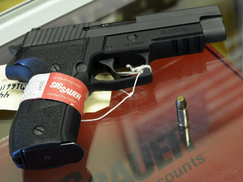 A Sig Sauer handgun on sale at a shop in Tucker, Ga.