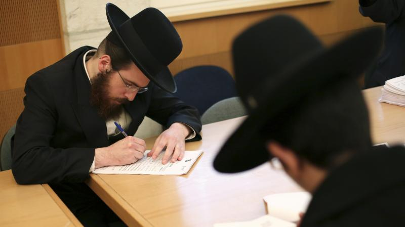 Ultra-Orthodox Jews are not required to perform military service in Israel, and the issue is subject to intense debate following the country's election last week. Here, ultra-Orthodox men sign up for alternate civilian service earlier this month.
