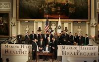 Then-Gov. Mitt Romney signs the Massachusetts health care bill in Boston on April 12, 2006.