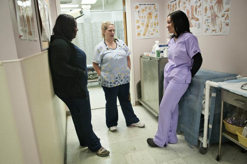 Peggy Renzi (middle) talks with her teammates Erika Hersey (left) and Erica Webster. The three are part of a team of nurses in the Bowie Health Center emergency room in Bowie, Md., who are working together to lose weight.