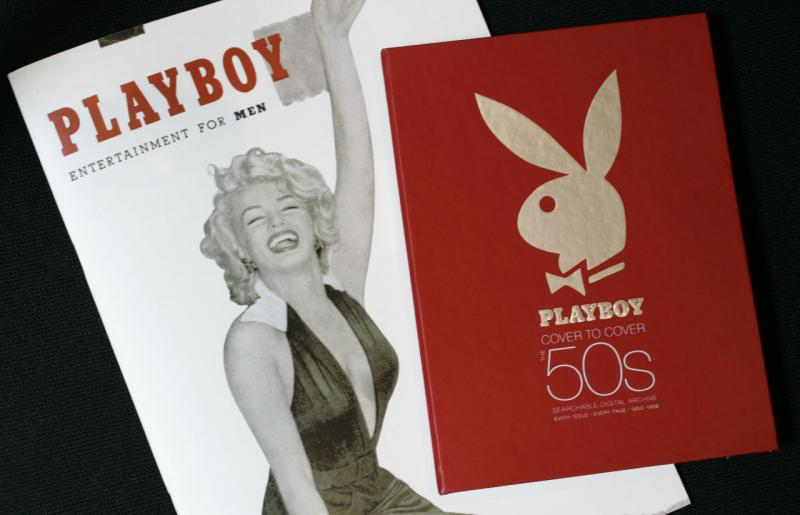 The first issue of Playboy magazine featuring Marilyn Monroe, left, and a boxed DVD set of Playboy magazines from the 1950s are shown in New York on Monday, July 16, 2007. (Mark Lennihan/AP)