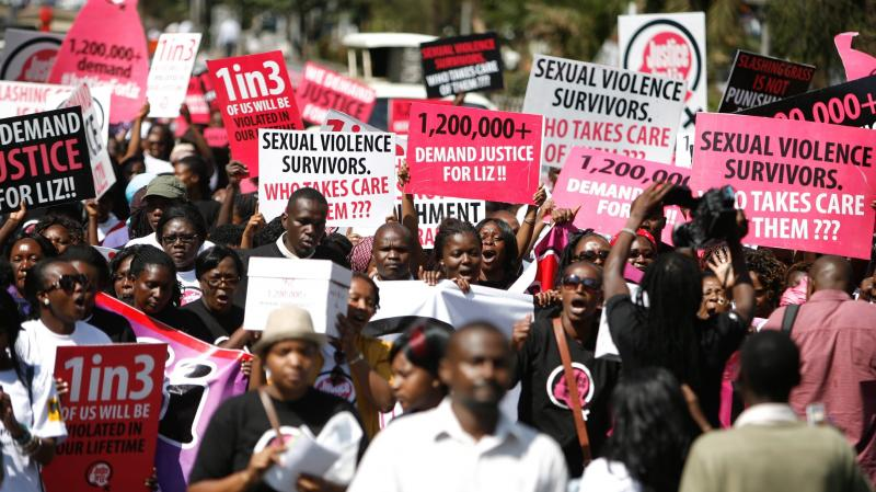 """Hundreds take to the streets in Nairobi on Thursday, calling for justice for a 16-year-old girl dubbed """"Liz,"""" who was gang raped in rural Kenya. The men were caught by the police and let go after their punishment — cutting the grass at the police statio"""