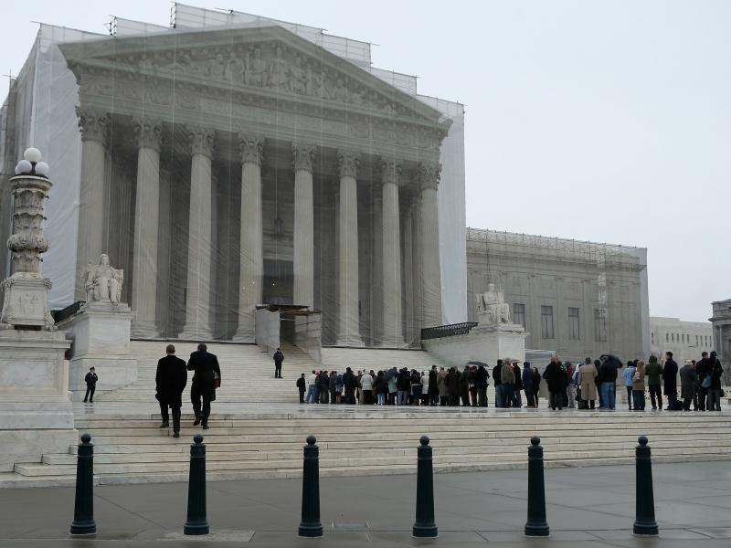 People stand in line outside the U.S. Supreme Court on Monday.