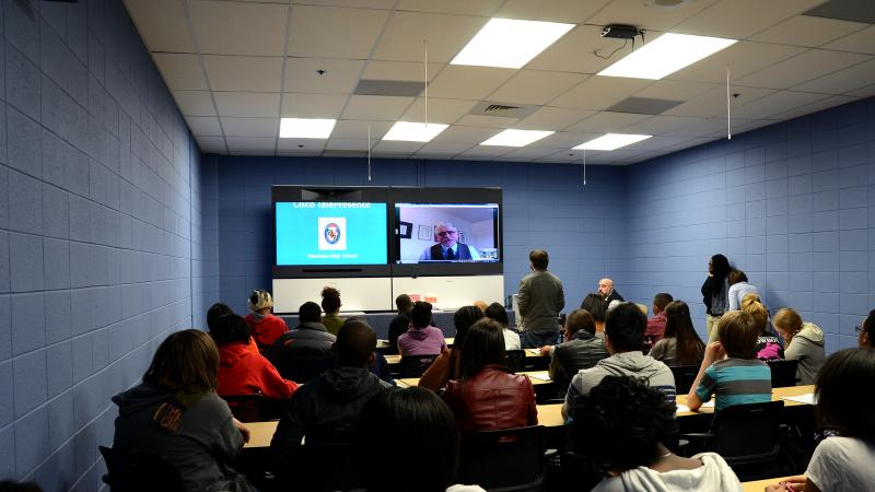 """Students at Westlake High School in Waldorf, Md., participate in an interactive digital conversation with historian Kenneth C. Davis about late 19th and early 20th century American history on Thursday. The school uses a state of the art """"telepresence cent"""