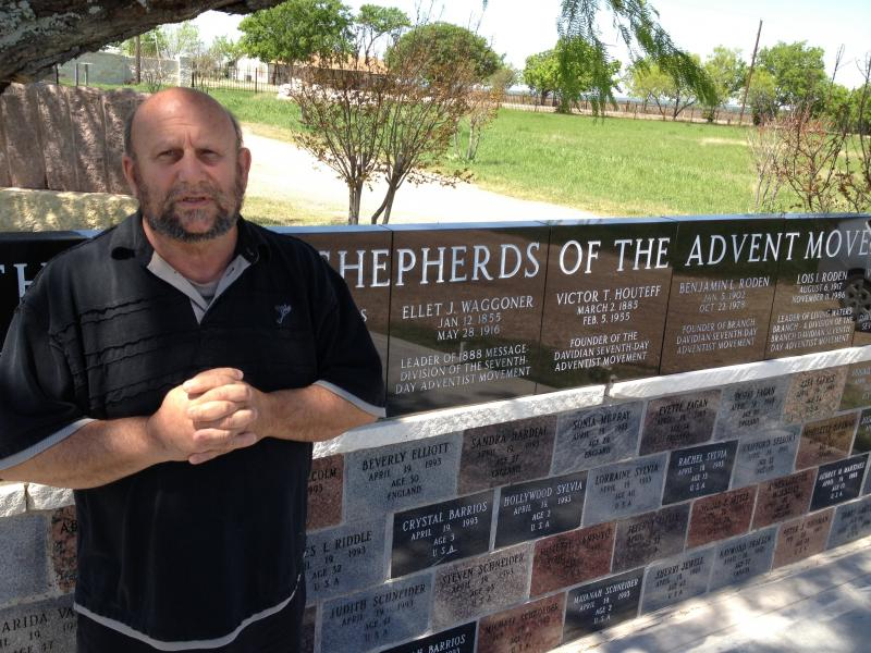 Charles Pace, the leader of a new group of Branch Davidians, stands next to a memorial for members of the sect killed during the ATF raid at Mount Carmel.