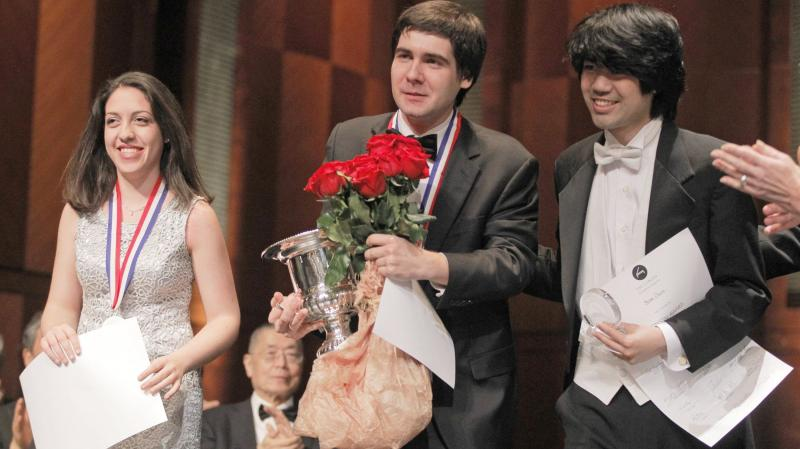 Cliburn medalists Beatrice Rana, second place winner; Vadym Kholodenko, first place winner; and Sean Chen, third place winner, receive applause from the audience at the final awards ceremony at the 14th Van Cliburn International Piano Competition on Sunda