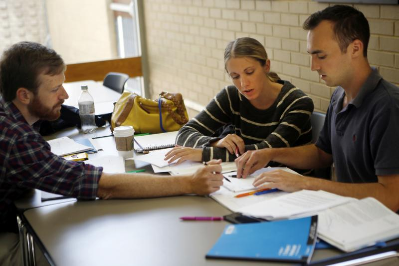 From left, Garrett Berntsen, Jennifer Majer and William Shields compare notes at The Johns Hopkins University School of Advanced International Studies in Washington, D.C. Twenty-somethings have new choices under Obamacare.