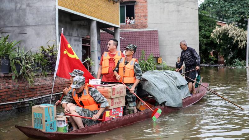Community workers and volunteers deliver food and supplies to flood-affected residents after heavy rains in Neijiang in China's southwestern Sichuan province on Wednesday.