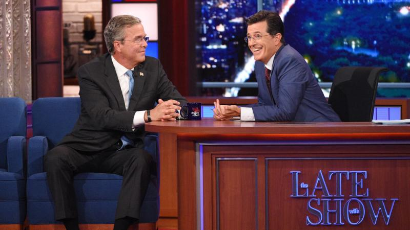 Stephen Colbert (right) talks with Republican presidential candidate Jeb Bush during Colbert's debut as Late Show host in New York.