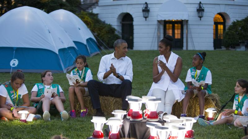 President Obama and Michelle Obama went a little Troop Beverly Hills at a Girl Scout campout on the South Lawn earlier this summer. We doubt survivalist Bear Grylls is going allow the president to bring those lanterns on their trek.