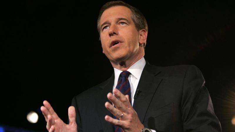 NBC's Brian Williams addresses the crowd while moderating a debate in 2008.