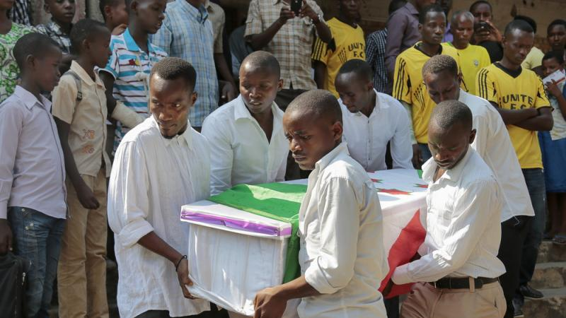 The coffin of Theogene Niyondiko, who was shot dead by police during an opposition demonstration last Friday, is carried in Burundi's capital Bujumbura on Tuesday. Protesters have been demonstrating against President Pierre Nkurunziza, who plans to run fo