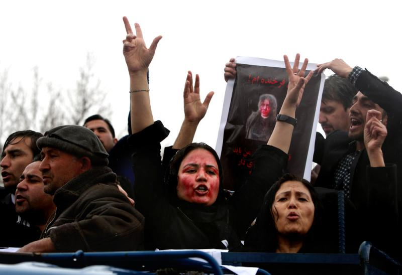 Afghan women demand justice for a woman who was beaten to death by a mob after being falsely accused of burning a Quran, at a demonstration in March.