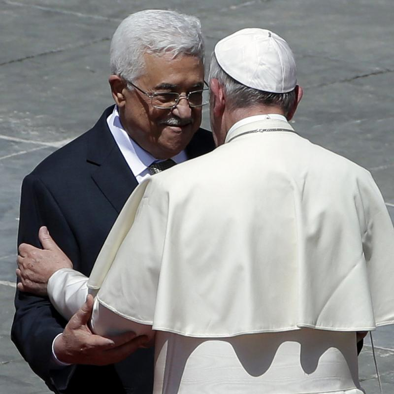 Pope Francis greets Palestinian President Mahmoud Abbas following a canonization ceremony for four nuns, including two Palestinians, in St. Peter's Square at the Vatican, on Sunday.