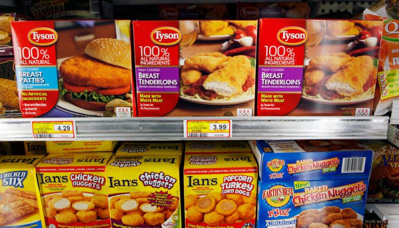 Tyson Foods says it has already reduced its use of human-use antibiotics by 80 percent over the past four years. Here, Tyson frozen chicken on display at Piazza's market in Palo Alto, Calif., in 2010.