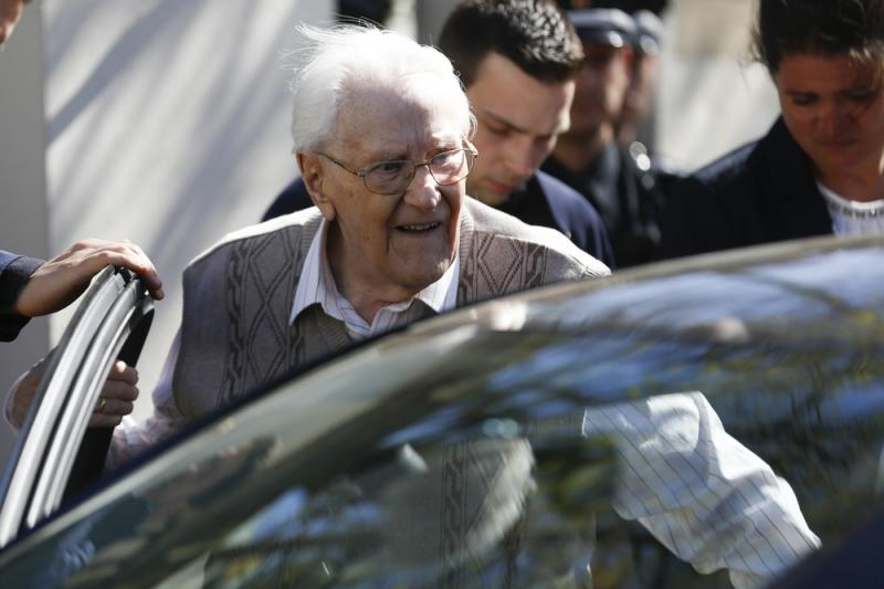 Former SS guard Oskar Groening, now 93, enters a car after the first day of his trial in Lueneburg, Germany, on Tuesday. He faces 300,000 counts of accessory to murder, in a case that tests the argument that anyone who served at a Nazi death camp was comp