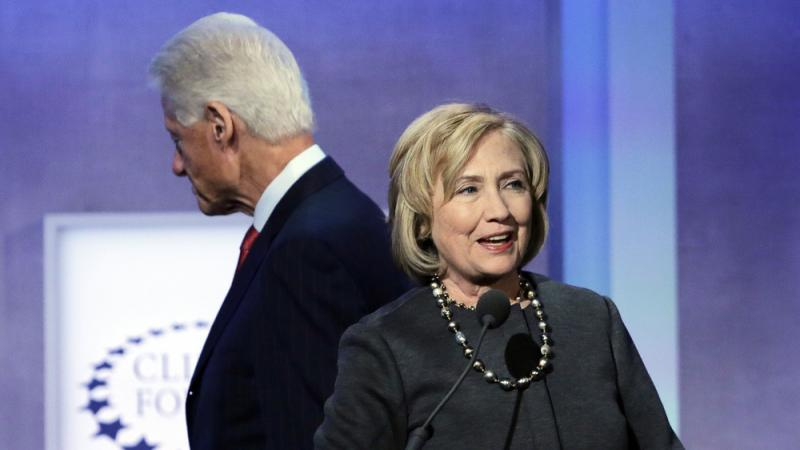 Hillary Clinton begins to speak as her husband, former President Bill Clinton, moves to take a seat after introducing her at the Clinton Global Initiative on Sept. 22, 2014, in New York.