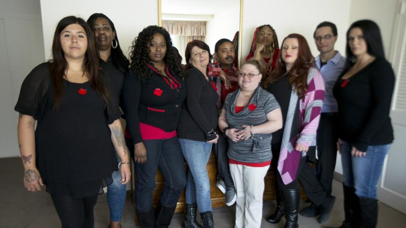 Makenzie Vasquez (from left), Pamala Hunt, Latonya Suggs, Ann Bowers, Nathan Hornes, Ashlee Schmidt, Natasha Hornes, Tasha Courtright, Michael Adorno and Sarah Dieffenbacher are refusing to pay back loans they took out to attend Corinthian Colleges.