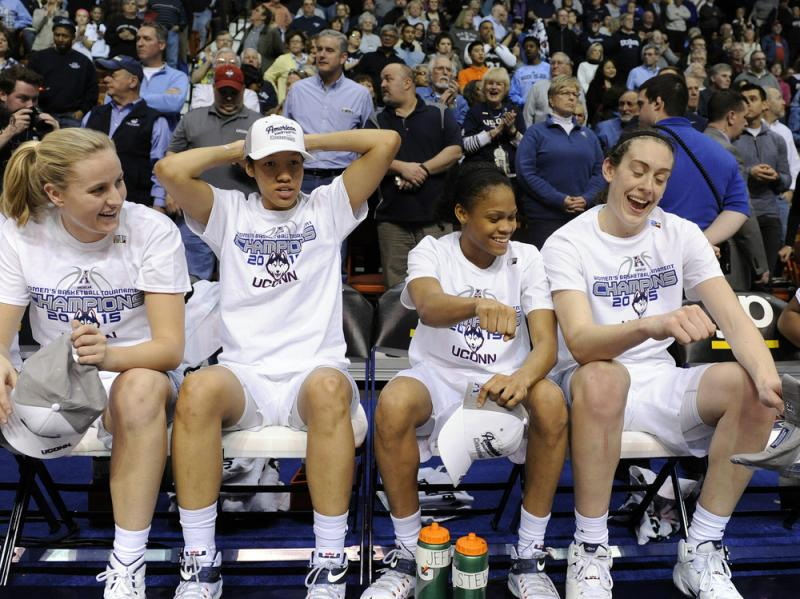 Members of Connecticut's women's basketball team react after their 84-70 victory over USF in an NCAA college basketball game in the finals of the American Athletic Conference tournament. UConn is the returning champ in this year's women's bracket.