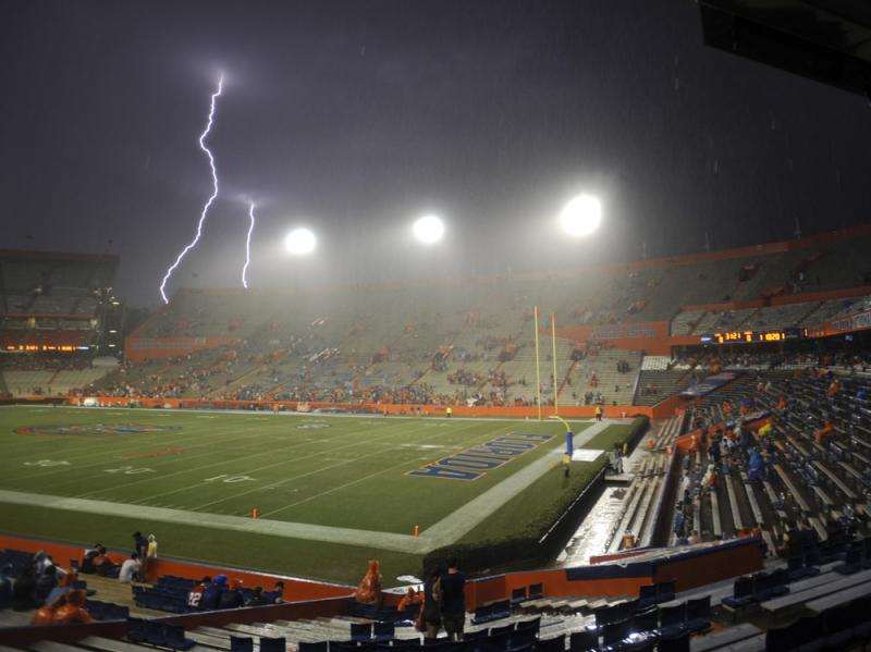 Lightning strikes near Ben Hill Griffin Stadium at Florida Field in Gainesville, Fla., in August. A new study says a rise in average global temperatures due to climate change will increase the frequency of lightning strikes.