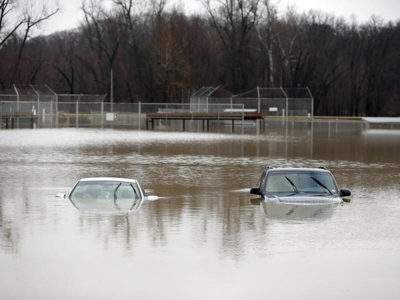 Two cars are submerged in floodwaters in a park in Kimmswick, Mo. Gov. Jay Nixon has declared a state of emergency because of widespread flooding around the state, which has closed many roads.