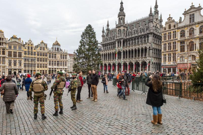 Soldiers patrol outside the Grand Place in Brussels on Tuesday. Police arrested two people on suspicion of planning attacks at tourist spots in the city over the holidays.