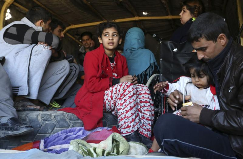 Civilians are loaded in a truck to be taken to safe places Thursday as Iraqi security forces clear the Soufiya neighborhood of Islamic State fighters in central Ramadi, 70 miles west of Baghdad, Iraq.