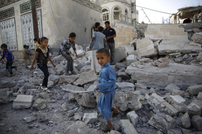 Children play amid the rubble of a house destroyed by a 2015 Saudi-led airstrike in Yemen's capital Sanaa.